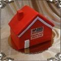 41 Tort  w kształcie domu budynek dla firmy nieruchomości