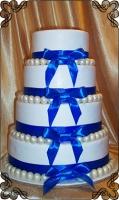 39 tort weselny z białymi kołami perlami z czekolady cukiernia pod arkadami