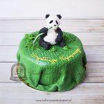 Tort miś panda jedzący pędy bambusa
