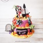Tort VAIANA Skarb oceanu - Moana z łódką na egzotycznej plaży udekorowanej kwiatami, palmami i muszlami