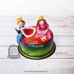 Tort z figurkami królewny i królewicza