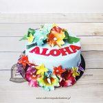 Tort hawajski z kwiatami i napisem ALOHA