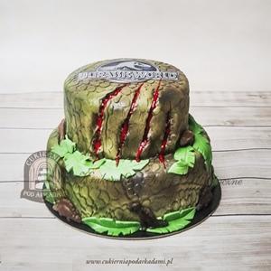 Tort Jurassic Park zadrapany łapą dinozaura