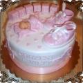 29 Tort z różowymi klockami bucikami i kołderką na chrzest