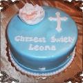 35  Tort na niebieskim tle z krzyżem i dzieckiem w  kołysce