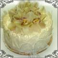22 Tort okolicznościowy ze storczykiem cymbidium w białej czekoladzie Cukiernia Pod Arkadami Kraków