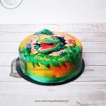 Foto-tort z tyranozaurem zdobiony liśćmi i cieniowany aerografem
