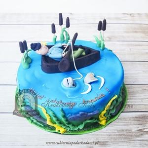 Tort w wędkarzem w łódce