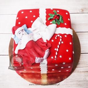 Tort w kształcie prezentu ze śpiącym Mikołajem
