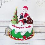 Tort z figurką Mikołaja, choinką i bałwankiem
