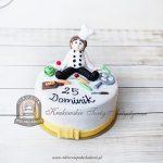 Tort z figurką kucharza